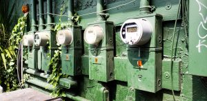 Power meters at the beach painted green read amout of electricity used in the small business .